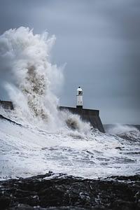 Photo by Marcus Woodbridge on Unsplash Storm around Lighthouse