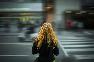 Woman standing and waiting at crossroads
