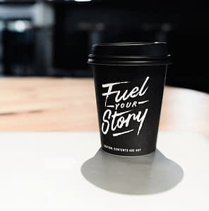 Copywriting coffee cup with logo Fuel your Story
