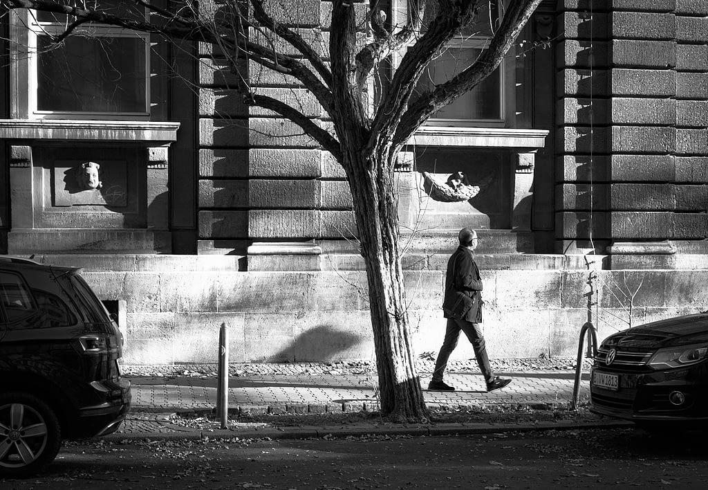 Tree and man walking past, Berlin, Sean P. Durham, 2020 (C)